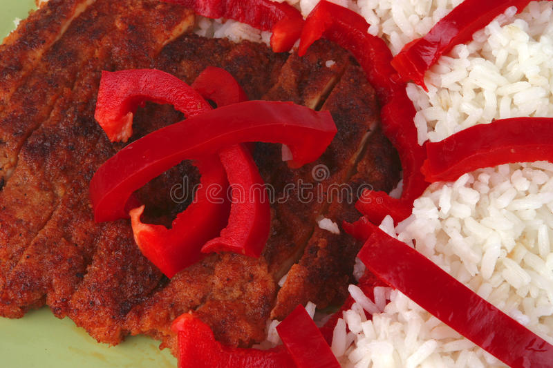 Roast meat with rice and pepper. Roast meat with rice and red pepper royalty free stock photo