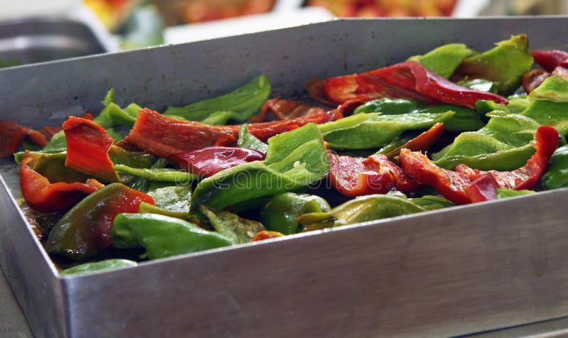 Roast peppers on the grill. With olive oil. Meals prepared vegetables with fast healthy, and during the preparation process to preserve a lot of vitamins stock image