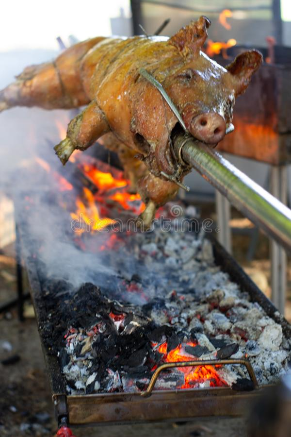 Roast pig on a spit. Pig cooking in Germany stock photo
