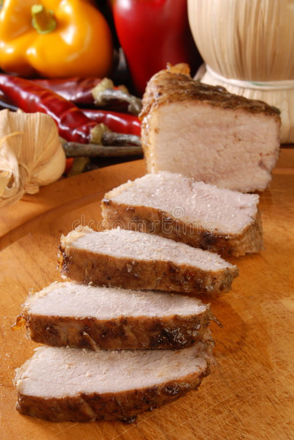 Roast pork. On a wooden board stock photography