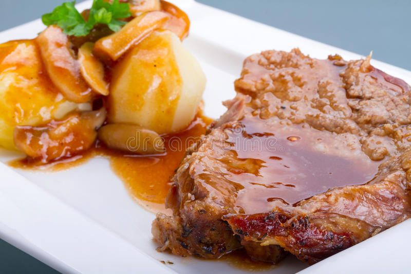 Roast Pork With Gravy And Potatoes Stock Photography