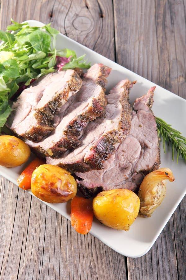 Roast pork neck stock images