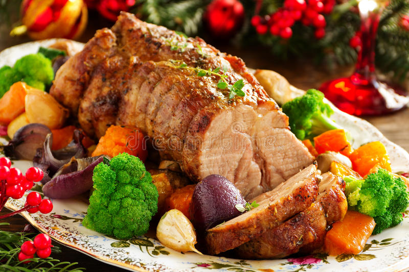 Roast pork with vegetables. And spices stock photography