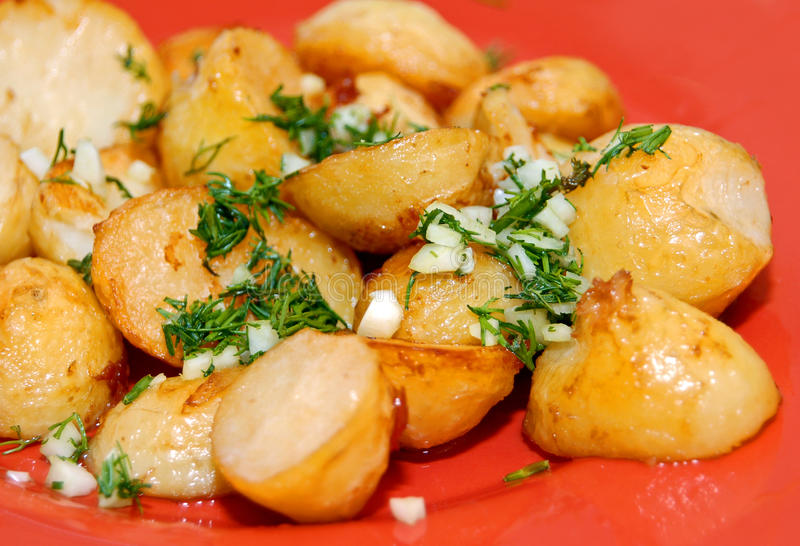 Roast potato. With garlic and punch stock images