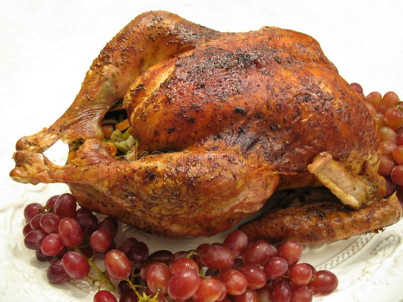 Roast Thanksgiving Turkey. Photo of roast Thanksgiving Turkey garnised with red grapes