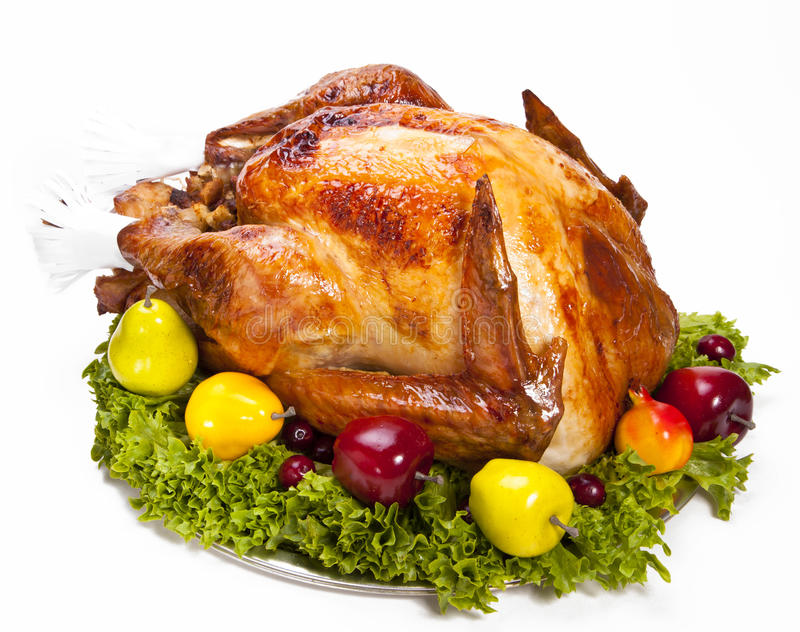 Roast Turkey. With stuffing on a platter on white stock photography