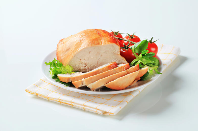 Roast turkey breast on a plate royalty free stock photos