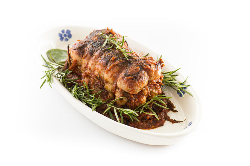 Roast of veal with rosemary in white background royalty free stock images