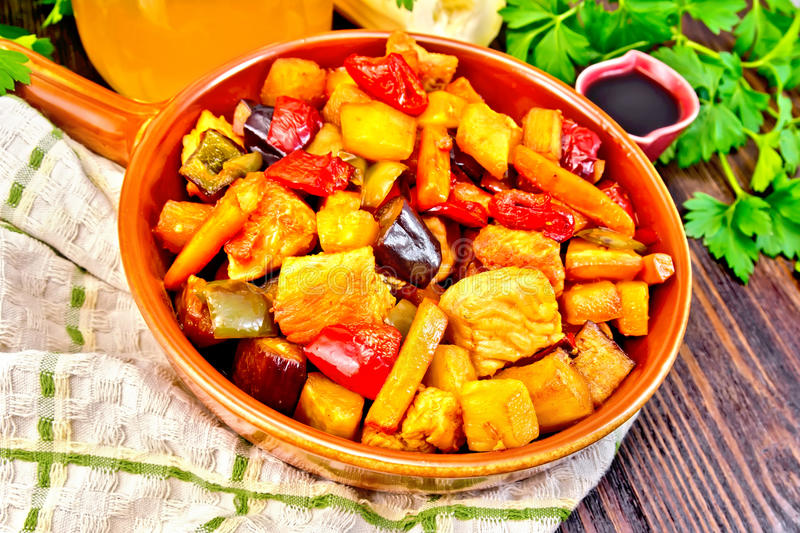 Roast with vegetables and honey in pan on board royalty free stock photos