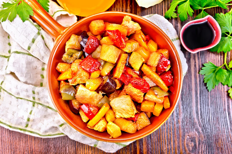 Roast with vegetables and honey in pan on board top stock image
