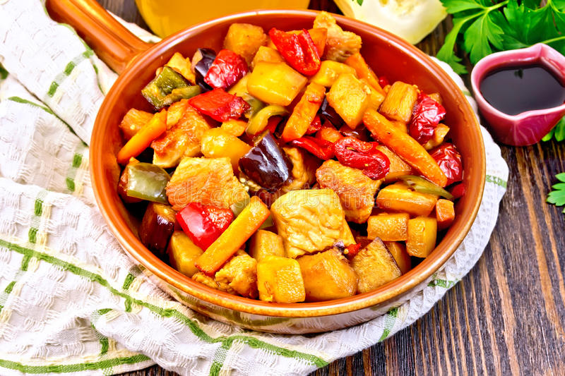 Roast with vegetables and honey in pan on napkin stock photos