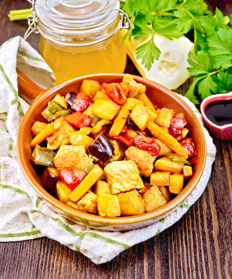 Roast with vegetables and honey in pan on towel royalty free stock image