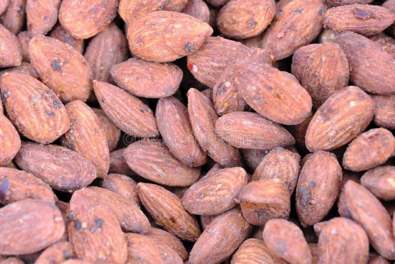 Roasted almond kernels coated stock image