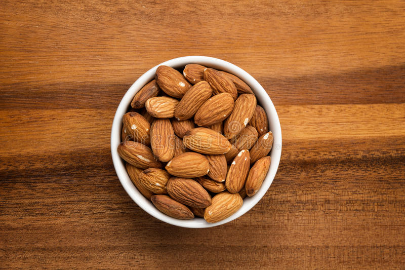 Download Roasted Almonds In White Porcelain Bowl Stock Photo - Image: 29226982