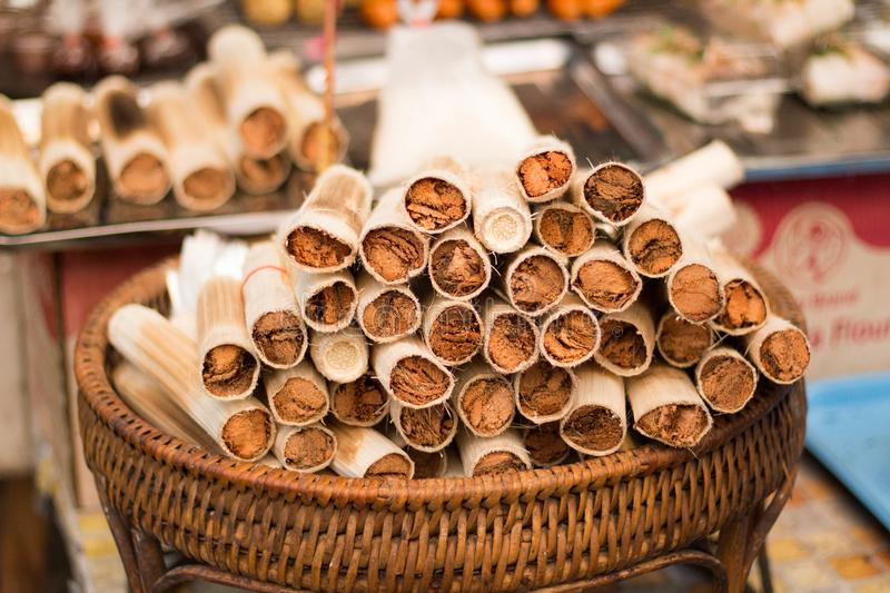 Roasted bamboo with sticky rice in Chiang Mai market, Thailand royalty free stock image