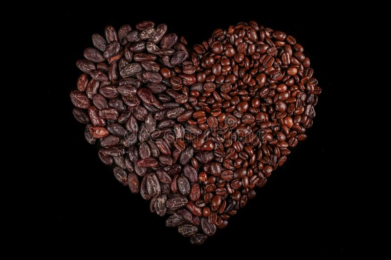 Roasted beans. Cocoa beans and coffee beans. Roasted beans. Cocoa beans and coffee beans isolated on black background stock image