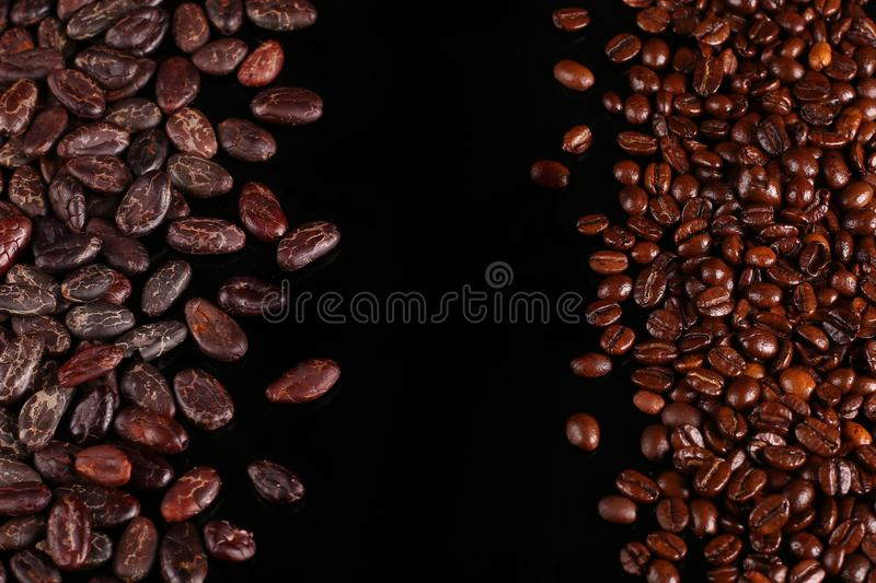 Roasted beans. Cocoa beans and coffee beans. Roasted beans. Cocoa beans and coffee beans isolated on black background royalty free stock image