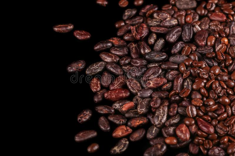 Roasted beans. Cocoa beans and coffee beans. Roasted beans. Cocoa beans and coffee beans  on black background royalty free stock photography