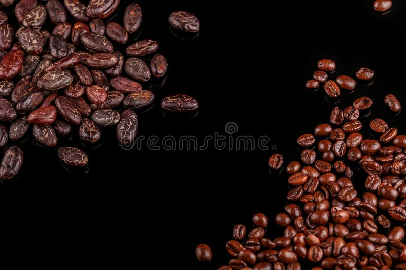 Roasted beans. Cocoa beans and coffee beans. Roasted beans. Cocoa beans and coffee beans  on black background stock image