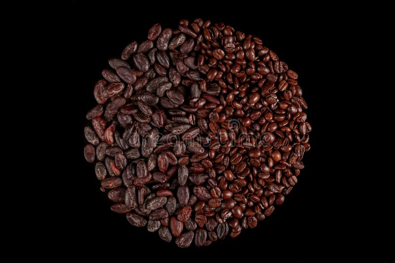 Roasted beans. Cocoa beans and coffee beans. Roasted beans. Cocoa beans and coffee beans isolated on black background royalty free stock photography