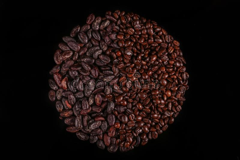 Roasted beans. Cocoa beans and coffee beans. Roasted beans. Cocoa beans and coffee beans isolated on black background royalty free stock images