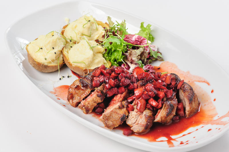 Roasted beef with berry and apple sauce royalty free stock image