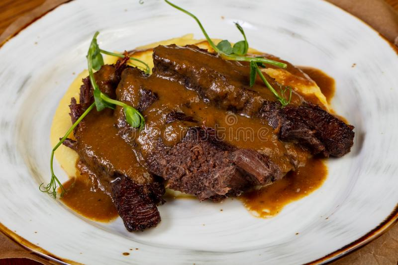 Roasted beef with gravy royalty free stock photography