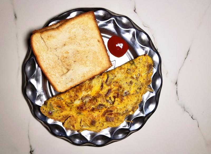 Roasted bread and omelette stock image
