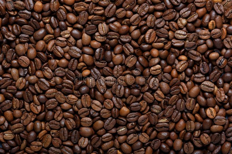 Roasted brown coffee beans, can be used as a background and texture stock image