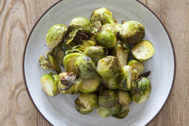Roasted Brussel Sprouts. On a Wooden Table stock photo