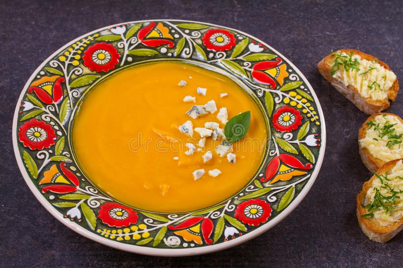 Roasted Butternut Squash Soup with Blue Cheese and Garlic Butter Toasts. Fruit and Vegetable Creamy Soup. Roasted Butternut Squash Soup with Blue Cheese and stock images