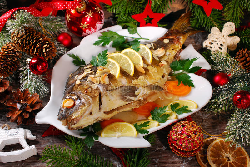 Roasted carp stuffed with vegetables for christmas stock photography