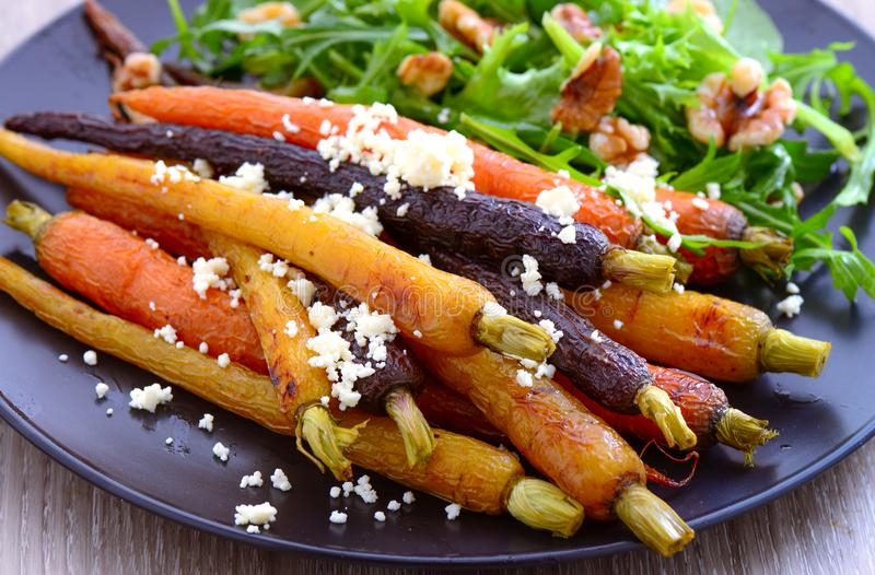 Roasted carrot salad. With feta cheese and greens royalty free stock photography