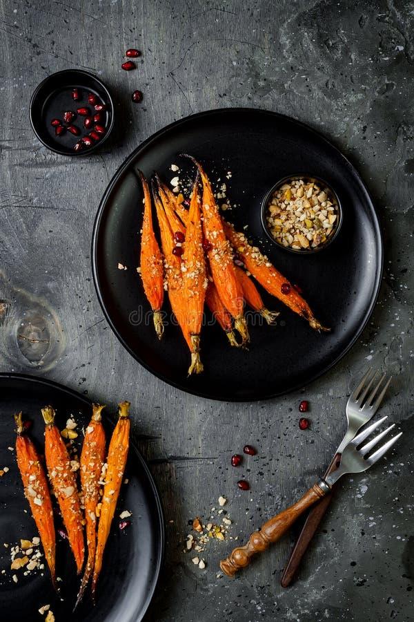 Roasted carrots with dukkah. Vegetarian food. Top view, flat lay. Roasted carrots with dukkah. Vegetarian food. Top view, flat lay royalty free stock image