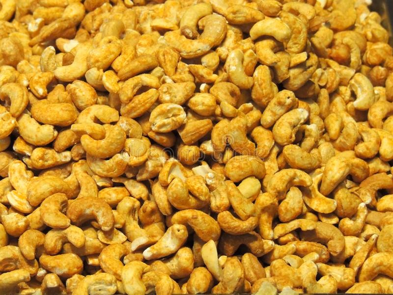 Roasted cashews. Cashew nuts in a giant pile in a delicatessen counter royalty free stock photography