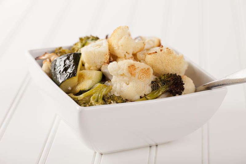 Roasted Cauliflower, Broccoli, and Zuccini angled view. Roasted Cauliflower, Broccoli, and Zucchini drizzled with Avocado oil and seasoned salt top view royalty free stock photos