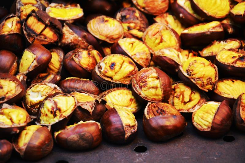 Roasted chestnuts, background royalty free stock photos