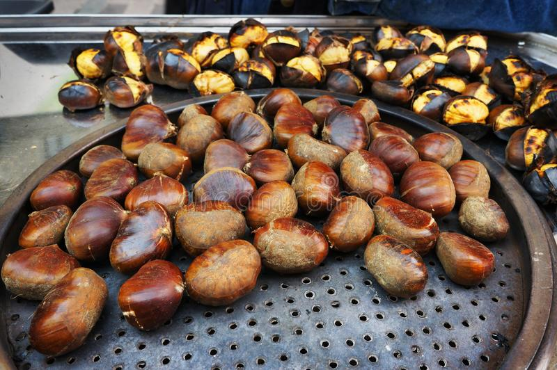 Roasted chestnuts cooking. Street food in Istanbul, Turkey stock images