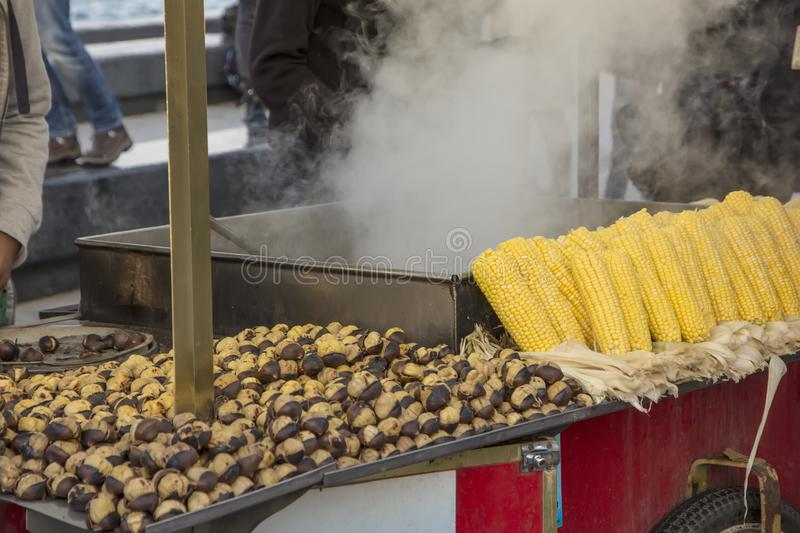 Roasted chestnuts and corn on the cobs in street vendors. Popular food among tourists and Turks. Istanbul, Turkey stock photos