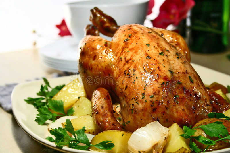 Roasted Chicken. Chicken, roasted with herbs and potatoes stock photos