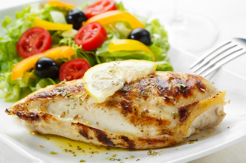 Roasted chicken breast. With salad stock images