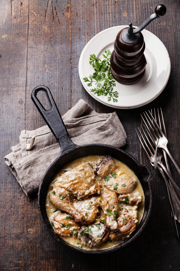 Roasted chicken with creamy garlic sauce stock photos