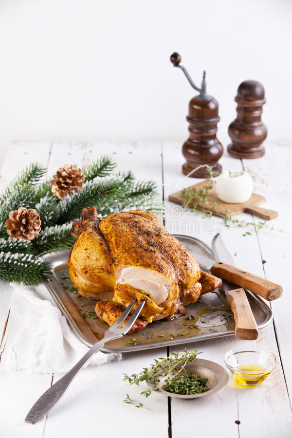 Roasted Chicken and Fir Christmas branch royalty free stock photo