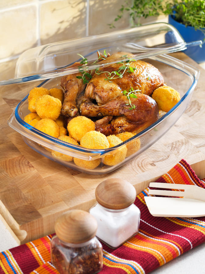 Roasted chicken in the heatproof bowl. Roasted chicken in the heat resistant bowl royalty free stock image