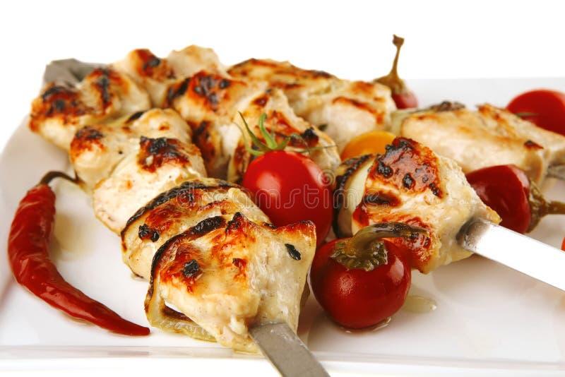 Roasted chicken kebab on white. Fresh roast chicken shish kebab on white platter stock photography