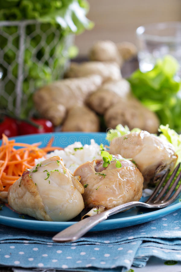Roasted chicken legs with rice. And vegetables royalty free stock image