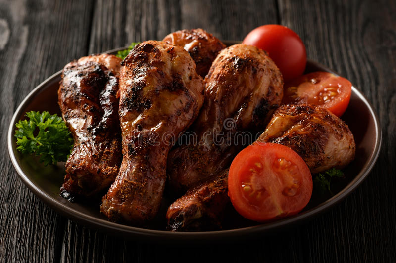Roasted chicken legs with tomatoes and boiled rice.  stock image