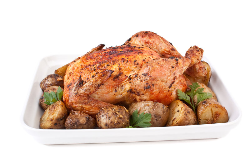 Roasted chicken and potatoes stock images