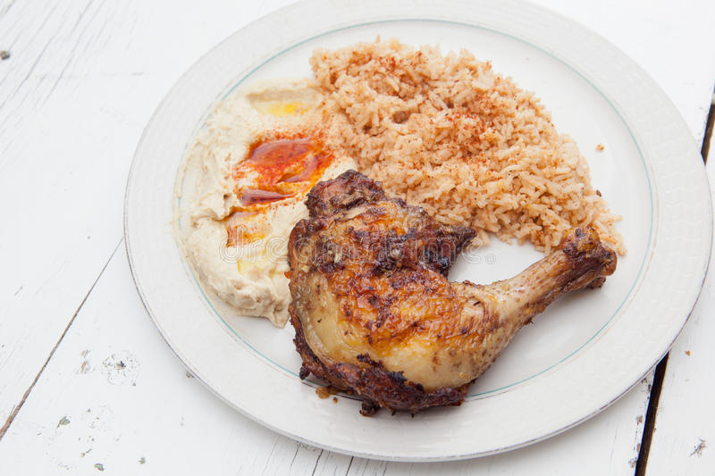 Download Roasted Chicken With Saffron Rice And Hummus Stock Image - Image: 28978065