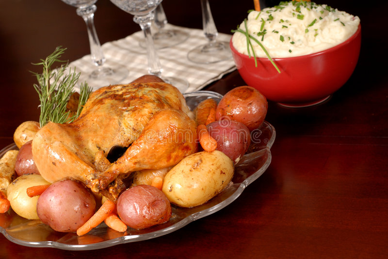 Roasted chicken and vegetables with mashed potatoes and rosemary stock images